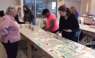 Terri Kirby Hathaway (left) shares activities from her book NC's Amazing Coast with EGRET Fellows teachers.