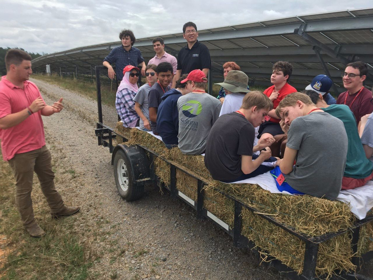 Dylan Burns and his group on a hay wagon