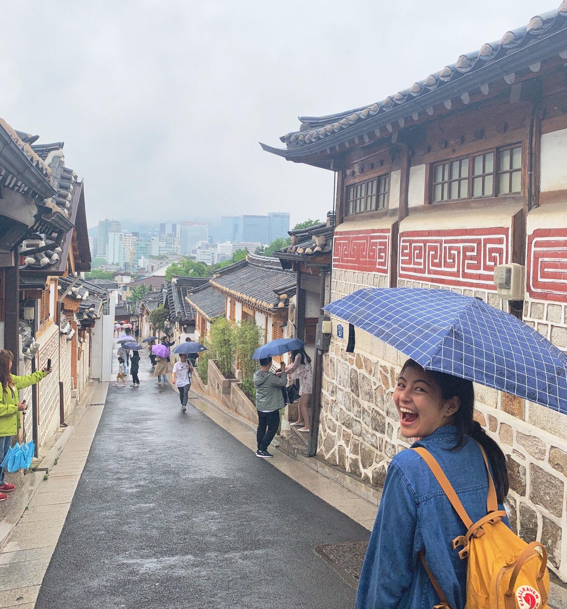 Brianna Chan with an umbrella