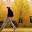 student walking in front of Hanes Art building