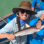 Savannah Ryburn holds a juvenile blacktip shark during her fieldwork in the Galapagos.